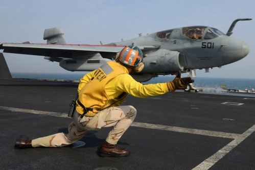U.S. 5TH FLEET AREA OF RESPONSIBILITY (Jan. 6, 2013) Lt. Ron Rumfelt signals for the launch of an EA-6B Prowler from the aircraft carrier USS John C. Stennis (CVN 74).