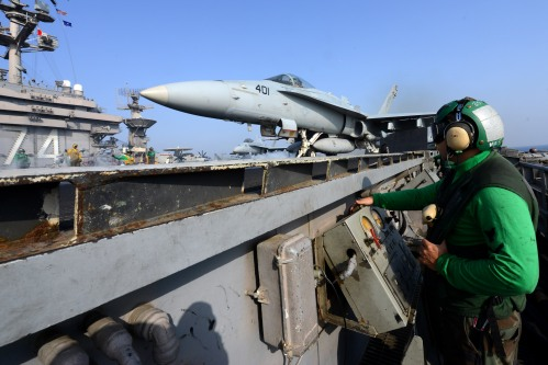 U.S. 5TH FLEET AREA OF RESPONSIBILITY (Jan. 21, 2013) Aviation Boatswain's Mate (Equipment) 3rd Class Samuel Perez launches an F/A-18C Hornet from the Golden Dragons of Strike Fighter Squadron (VFA) 192 from aircraft carrier USS John C. Stennis (CVN 74).