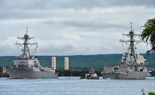 PEARL HARBOR (Jan. 28, 2013) Sailors aboard the guided-missile destroyer USS Michael Murphy (DDG 112) render passing honors to the guided-missile destroyer USS Gridley (DDG 101) as the destroyers move past Joint Base Pearl Harbor-Hickam.
