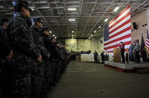 Martha Martin, board member of Operation Gratitude, thanks the crew in the hangar bay of the aircraft carrier USS Ronald Reagan (CVN 76). Martin visited the ship to deliver thousands of care packages to the ship's crew.