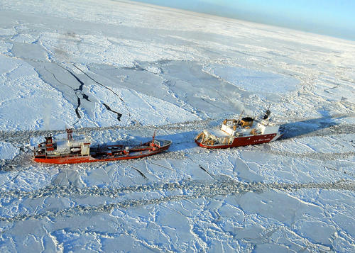 The Coast Guard Cutter Healy escorts the Russian-flagged tanker Renda 250 miles south of Nome Jan. 6, 2012. The vessels are transiting through ice up to five-feet thick in this area.