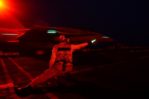 (Jan. 31, 2013) A catapult and arresting gear officer signals for the launch of an aircraft from the aircraft carrier USS John C. Stennis (CVN 74). John C. Stennis is deployed to the U.S. 5th Fleet.
