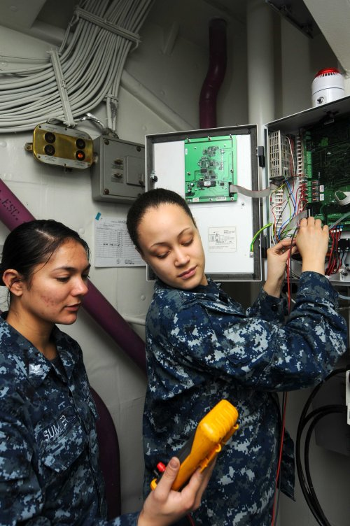 NAVAL BASE KITSAP-BREMERTON, Wash. (Feb. 14, 2013) Interior Communications Electrician Fireman Karlie Bryant and Interior Communications Electrician 3rd Class Carolyn Sumner troubleshoot a halo-carbon alarm system aboard the aircraft carrier USS Ronald Reagan (CVN 76). Reagan is homeported in Bremerton, Wash., while undergoing a docked planned incremental availability maintenance period at Puget Sound Naval Shipyard & Intermediate Maintenance Facility.