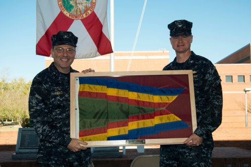 KINGS BAY, Ga. (Feb. 15, 2013) Rear Adm. Joseph Tofalo, commander, Submarine Group 10, presents the Navy Unit Commendation (NUC) to Capt. David Kirk, commanding officer of the guided-missile submarine USS Florida (SSGN 728) gold crew.