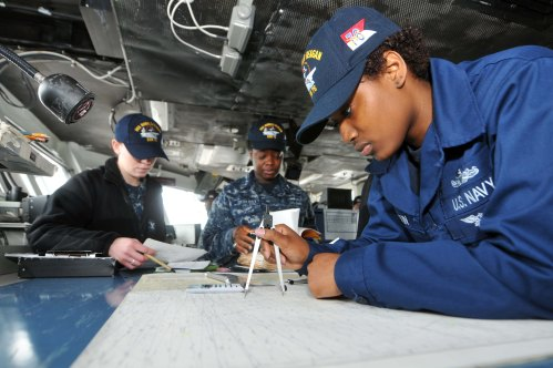 NAVAL BASE KITSAP-BREMERTON, Wash. (March. 7, 2013) Quartermaster Seaman Jerrinysha Boutin, from New Orleans, plots a course aboard the aircraft carrier USS Ronald Reagan (CVN 76). Ronald Reagan has spent the last year in a docking planned incremental availability at Puget Sound Naval Shipyard and Intermediate Maintenance Facility and is currently making preparations to get underway.