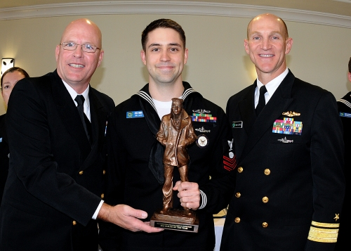 SAN DIEGO (March 1, 2013) - Electrician's Mate 1st Class (SS) Franklin Tenney (center) stationed aboard USS Maine (SSBN-741)(BLUE) in Bremerton, Wash., is awarded Commander, Submarine Force U.S. Pacific Fleet Sea Sailor of the Year for 2012 by Rear Adm. James Caldwell (right) and Force Master Chief Michael Caldwell (left).