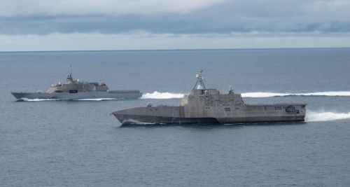 SAN DIEGO (May 2, 2012) The first of class littoral combat ships USS Freedom (LCS 1), left, and USS Independence (LCS 2), maneuver together during an exercise off the coast of Southern California.