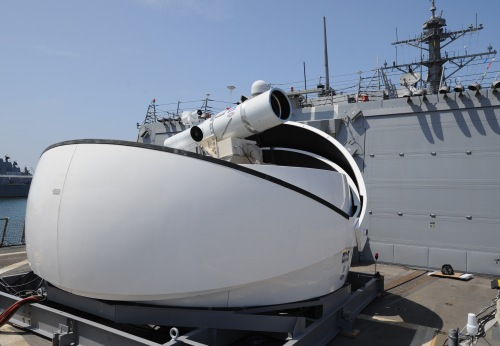 SAN DIEGO (July 30, 2012) The Laser Weapon System (LaWS) temporarily installed aboard the guided-missile destroyer USS Dewey (DDG 105) in San Diego, Calif., is a technology demonstrator built by the Naval Sea Systems Command from commercial fiber solid state lasers, utilizing combination methods developed at the Naval Research Laboratory. LaWS can be directed onto targets from the radar track obtained from a MK 15 Phalanx Close-In Weapon system or other targeting source. The Office of Naval Research's Solid State Laser (SSL) portfolio includes LaWS development and upgrades providing a quick reaction capability for the fleet with an affordable SSL weapon prototype. This capability provides Navy ships a method for Sailors to easily defeat small boat threats and aerial targets without using bullets.