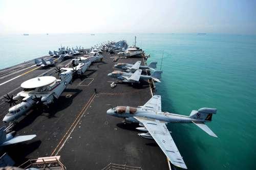 SINGAPORE (April 4, 2013) The Nimitz-class aircraft carrier USS John C. Stennis (CVN 74) gets underway.