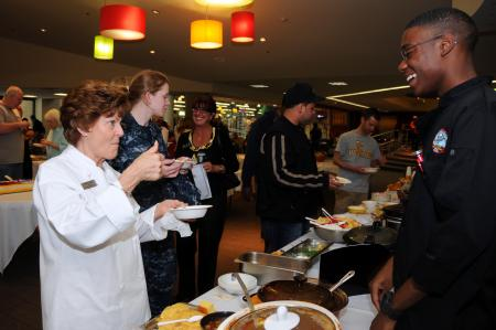 May 12 2012 Bremerton mayor Patty Lent gives Culinary Specialist Seaman Apprentice Kenzil Woodard from Winnsboro, S.C., assigned to the aircraft carrier USS Ronald Reagan (CVN 76), a thumbs up after taste testing chili during the Olympic College Foundation Military Culinary Arts Competition held in Bremerton.