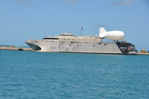 KEY WEST, Florida (April 23, 2013) The Military Sealift Command high-speed vessel Swift (HSV 2) and a tethered TIF-25K aerostat are moored at Mole Pier at Naval Air Station Key West prior to at sea testing for future Operation Martillo counter transnational organized crime operations while assigned to U.S. 4th Fleet.