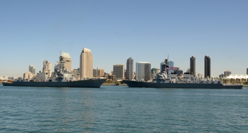 SAN DIEGO (April 19, 2013) The Arleigh Burke-class guided-missile destroyer USS Preble (DDG 88), right, passes USS Dewey (DDG 105) as it departs homeport in San Diego for a six-month deployment to the U.S. 7th Fleet