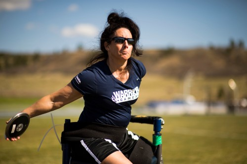 COLORADO SPRINGS, Colo. (May 12, 2013) Navy Mineman 1st Class Linda Simpson performs a seated discus throw during a team Navy Coast Guard track and field practice at the 2013 Warrior Games. From May 11-16, More than 200 wounded, ill and injured service members and veterans, as well as an international team representing the United Kingdom, will compete at the U.S. Olympic Training Center and U.S. Air Force Academy. The military service with the most medals will win the Chairman's Cup. (U.S. Navy photo)