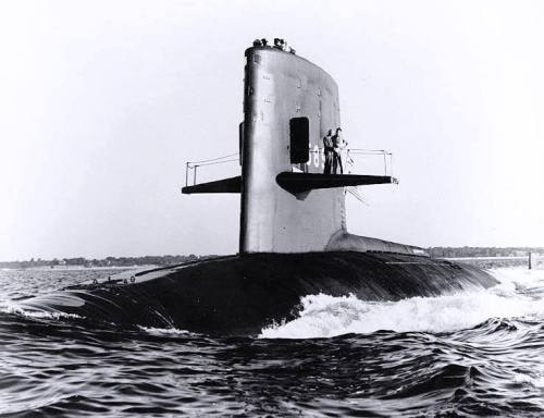 USS Scorpion (SSN-589). Photographed on 27 June 1960, off New London, Connecticut, during builder's trials. Vice Admiral Hyman G. Rickover is standing on her sailplanes with another officer.
