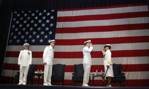 Rear Adm. (select) Bette Bolivar (right) takes command of Navy Region Northwest from Rear Adm. Mark Rich. With them on the stage were Capt. John Swanson (far left) and Vice Adm. William French. - Kitsap Sun