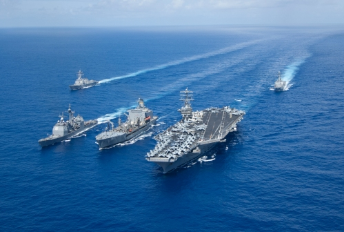 The guided-missile cruiser USS Princeton (CG 59), the Military Sealift Command fleet replenishment oiler USNS Guadalupe (T-AO 200), and the aircraft carrier USS Nimitz (CVN 68) participate in a replenishment at sea while the guided-missile destroyers USS Momsen (DDG 92) and USS Preble (DDG 88) are underway in formation.