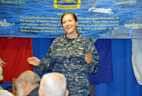Lt. Britta Christianson speaks at the July meeting for members of the U.S. Submarine Veterans Bremerton Base. Christianson became the first woman to qualify as a submariner supply officer after the Navy lifted its ban on females serving on subs in 2011.  NW Navy Life Photo