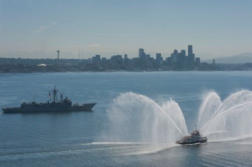 PUGET SOUND (July 9, 2013) The Oliver Hazard Perry-class guided-missile frigate USS Ford (FFG 54) passes Seattle, Wash. during a transit of Puget Sound during a plank owner's cruise. Ford is homeported at Naval Station Everett in Everett, Wash. (U.S. Navy photo)