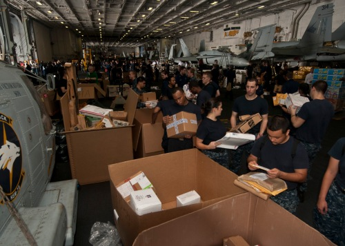 GULF OF OMAN (June 29, 2013) Sailors sort mail aboard the aircraft carrier USS Nimitz (CVN 68) while conducting a replenishment-at-sea. The Nimitz Carrier Strike Group is deployed to the U.S. 5th Fleet
