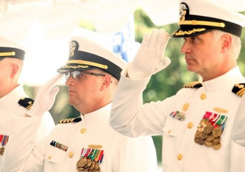 Capt. Christopher S. Quarles (left) and Capt. Christopher M. Culp salute the flag at the Naval Hospital Bremerton change-of-command ceremony Tuesday. Meegan M. Reed - KIitsap Sun