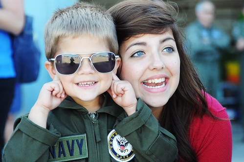 OAK HARBOR, Wash. (Sept. 9, 2013) The son and daughter of Lt. Cmdr. Ben Hartman wait for the homecoming of the Yellow Jackets of Electronic Attack Squadron (VAQ) 138 to Naval Air Station Whidbey Island after their six-month deployment
