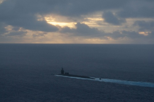 APRA HARBOR, Guam, The Ohio-class guided missile submarine USS Michigan (SSGN 727) heads out to sea
