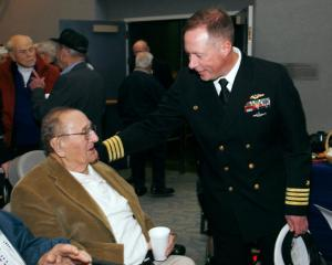 Gerhard Jensch, USS California, and Captain Dave Kohnke, Commander, NUWC Keyport, exchange laughs at the post-event reception. — at Naval Undersea Museum.