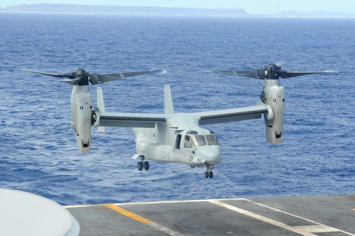 PHILIPPINE SEA (Nov. 17, 2013) A U.S. Marine Corps MV-22 Osprey lands on the flight deck of the U.S. Navy's forward-deployed aircraft carrier USS George Washington (CVN 73) to conduct refueling operations in support of Operation Damayan.