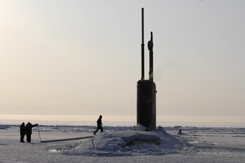 Los Angeles-class fast attack submarine USS Alexandria (SSN 757) is submerged after surfacing through two feet of drifting ice about 180 nautical miles off the north coast of Alaska.