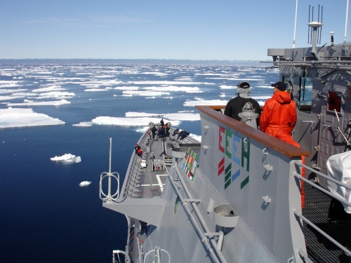 Ship's Serviceman Seaman Recruit Jamal Powell, left, and Seaman Recruit Stephen Harmon stand forward lookout watch aboard guided-missile cruiser USS Normandy (CG 60) as the ship navigates an ice field north of Iceland.