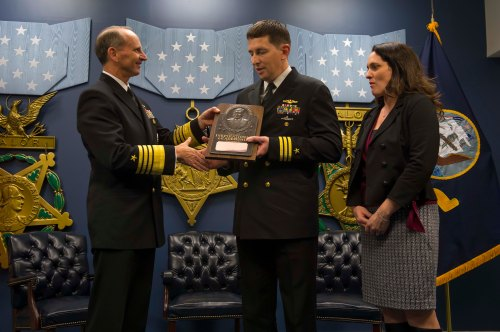 WASHINGTON (Dec. 4, 2013) Chief of Naval Operations (CNO) Adm. Jonathan Greenert presents the 2013 Vice Adm. James Bond Stockdale Leadership Award to U.S. Pacific Fleet recipient Cmdr. Richard N. Massie, former commanding officer of the ballistic-missile submarine USS Maine (SSBN 741 - Gold), in the Hall of Heroes at the Pentagon. The Stockdale Leadership Award is presented annually to two commissioned officers on active duty in the grade of commander or below who are serving in command of a single unit and who serve as examples of excellence in leadership and conspicuous contribution to the improvement of leadership in the Navy.