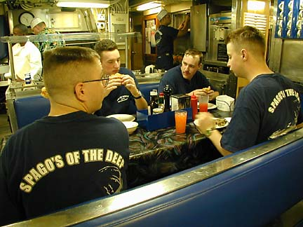 """Crew members on board the USS Los Angeles have affectionately dubbed its dining room """"Spago of the Deep."""" - By Craig T. Kojima, Star-Bulletin"""