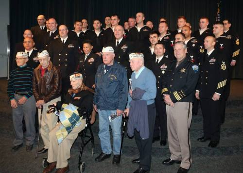 Pearl Harbor Survivors with uniformed personnel at the ceremony. From the left are: Frank Mattausch (Wheeler Army Airfield), Lloyd Valnes (USS California), Rocky Hoffman (Ewa Marine Station), Bob Rains (USS Pennsylvania) and Roy Carter (USS Oklahoma)