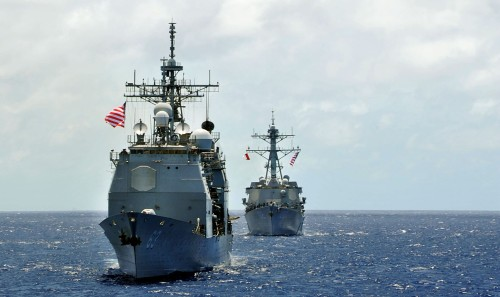 SOUTH CHINA SEA (July 4, 2012) The Ticonderoga-class guided-missile cruiser USS Cowpens (CG 63), front, and the Arleigh Burke-class guided-missile destroyer USS Sampson (DDG 102) steam in formation in the U.S. 7th Fleet