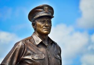 Bronze Statue of Fleet Admiral Chester Nimitz in front of the Battleship Missouri Memorial.