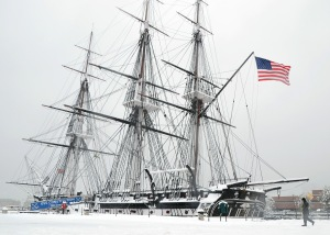 CHARLESTOWN, Mass. (Feb. 5, 2014) Master-at-Arms 3rd Class Garrett Thormodson, from Mondovi, Wis., approaches USS Constitution to assist fellow Sailors with shoveling the ship's spar deck during a snowstorm. The greater Boston area averages 43.8 inches of snow accumulation each winter, and Constitution crew members are responsible for keeping the decks of 'Old Ironsides' snow and ice-free.
