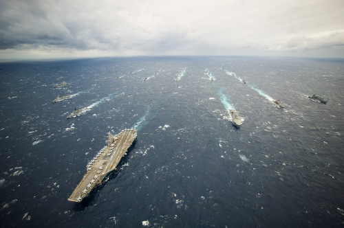 PHILIPPINE SEA (Nov. 28, 2013) The aircraft carrier USS George Washington (CVN 73), left, the George Washington Strike Group and Japan Maritime Self-Defense Force ships participate in tactical maneuver training during Annual Exercise (AnnualEx) 13