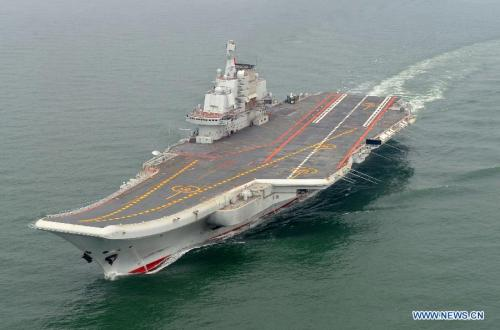 "Photo taken in May 2012 shows a Chinese aircraft carrier cruising for a test on the sea. China's first aircraft carrier was delivered and commissioned to the Navy of the Chinese People's Liberation Army on Sept. 25, 2012. The carrier, with the name ""Liaoning"" and hull number 16, was officially handed over to the Navy at a ceremony held in a naval base of northeast China's Dalian Port. (Xinhua/Li Tang)"