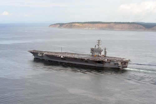 OAK HARBOR, Wash. (June 13, 2014) The aircraft carrier USS Nimitz (CVN 68) cruises in the Strait of Juan de Fuca. Nimitz is underway hosting friends and family day, an event where nearly 400 civilian guests joined the ship's crew for a special one day underway
