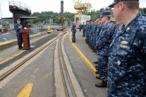 BANGOR, Wash. (June 18, 2014) Rear Adm. Dietrich Kuhlmann, commander of Submarine Group (SUBGRU) 9, speaks to the Blue and Gold crews of the ballistic missile submarine USS Pennsylvania (SSBN 735) during a Meritorious Unit Commendation presentation at Naval Base Kitsap-Bangor. Pennsylvania earned the award for completing the most successful return to service to date for an Ohio-class submarine following a refueling overhaul.