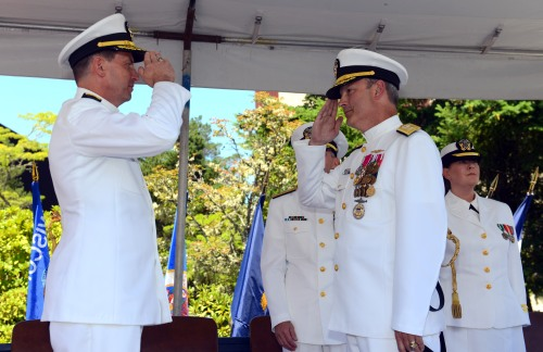 BANGOR, Wash. (July 11, 2014) Rear Adm. Dave M. Kriete, left, relieves Rear Adm. Dietrich H. Kuhlmann as commander of Submarine Group 9