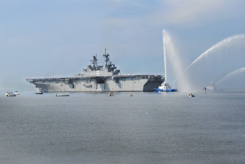 PASCAGOULA, Miss. (July 11, 2014) The future amphibious assault ship USS America (LHA 6) is saluted as it departs Huntington Ingalls Shipbuilding in Pascagoula, Miss. America  is scheduled to transit the U.S. Southern Command area of responsibility on its way to San Francisco for a scheduled commissioning ceremony Oct. 11.
