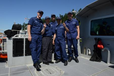 Christopher Marten (center left), a Washington state resident with exceptional needs; Cmdr. Thomas P. Sullivan (back), commanding officer of Maritime Force Protection Unit Bangor in Silverdale, Wash.; Petty Officer 3rd Class Charles T. Buchmeier (right), a boatswain's mate; and Petty Officer 2nd Class Joshua M. Sanders (left) and Petty Officer 2nd Class Daniel M. Caraballoa (center right), machinery technicians, pose for a photo aboard a 64-foot Special Purpose Craft--Screening Vessel moored at MFPU Bangor
