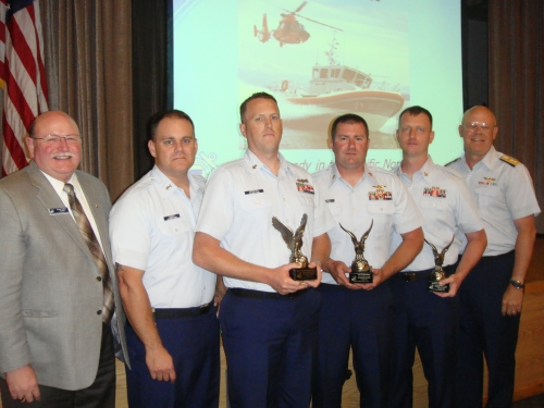 Three U.S. Coast Guard Enlisted Persons of the Quarter (EPOQs) were recognized by the Navy League of the United States Bremerton/Olympic Peninsula Council during an August 12th luncheon. Assembled left to right: Council President, Larry Salter; Thirteenth Coast Guard District Command Master Chief, BMCM Charles Lindsey; MK2 Christopher Morales, Coast Guard Station Seattle second quarter 2014 EPOQ; AMT1 Christian Williams, Coast Guard Air Station/Sector Field Office Port Angeles first quarter 2014 EPOQ; SK1 Brett Lively, Maritime Force Protection Unit--Bangor third quarter 2014 EPOQ; and Rear Admiral Richard Gromlich, Commander, Thirteenth Coast Guard District.