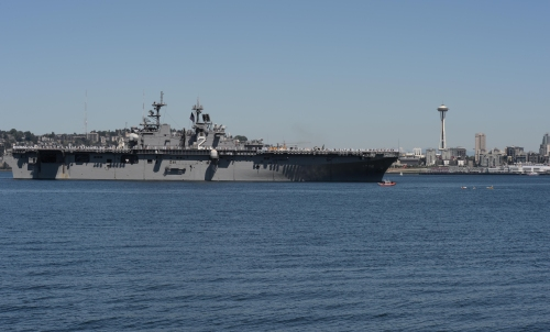 The Wasp-class amphibious assault ship USS Essex transits Elliott Bay during a parade of ships to kick off Seafair week