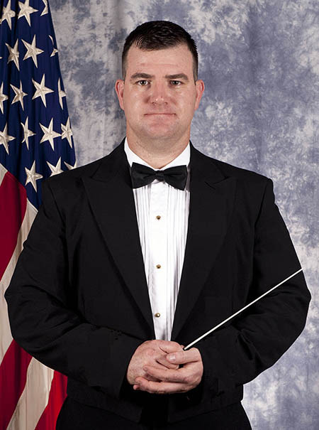 Lt. Bruce Mansfield, USN, director northwest Navy Band, is the new conductor of the Poulsbo Community Orchestra.