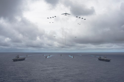 PACIFIC OCEAN (Sept. 23, 2014) Ships from the George Washington and Carl Vinson Carrier Strike Groups and Air Force and Marine Corps operate in formation at the conclusion of Valiant Shield 2014. The U.S.-only exercise integrates Navy, Air Force, Army, and Marine Corps assets and offers real-world joint operational experience to develop capabilities that provide a full range of options to defend U.S. interests and those of its allies and partners.