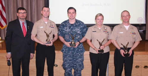 Four 2014 Commander, Submarine Group 9 Sailors of the Year (SOYs) were recognized by the Navy League of the United States Bremerton/Olympic Peninsula Council during a March 10th luncheon. Assembled right to left: Council President, Tim Katona; Junior Shore SOY, LS2(SS) Michael Porterfield; Junior Sea SOY, YN2(SS) Cody Browder; Shore SOY, NC1(SCW/FMF) Sara Dozier; and Sea SOY, MM1(SS) Christopher Smith.