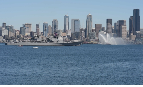 The Ticonderoga-class guided-missile cruiser USS Chancellorsville (CG 62) transits Elliott Bay during a parade of ships to kickoff Seafair week. Seafair activities allow the U.S. and Canadian Sailors and Coast Guardsmen to experience the local community and promote awareness of the maritime forces. (U.S. Navy photo by Mass Communication Specialist 2nd Class Justin A. Johndro/RELEASED)