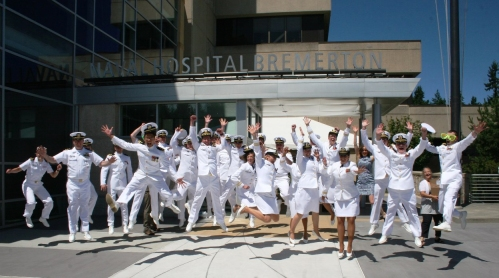 A collective jump for joy by Naval Hospital Bremerton's Puget Sound Family Medicine GME program staff and residents put an vertical exclamation point on the Family Medicine Resident Graduation Ceremony held June 26, 2015. The ceremony showcased Navy Medicine's strategic imperatives of Readiness, Value and Jointness by featuring four third year residents who are becoming the Navy's newest family physicians, with each transferring to other duty stations throughout the fleet (Official Navy photo by Douglas H Stutz, NHB Public Affairs).